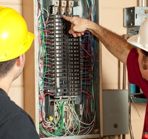 Electrical Inspection Services | Inspector looking at electrics